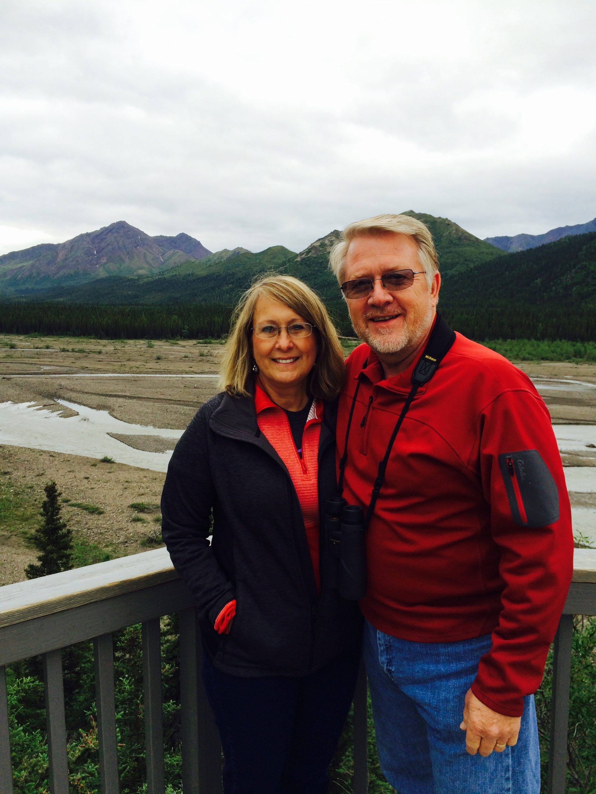 Patient Dan Sedlacek and wife with mountains in the background