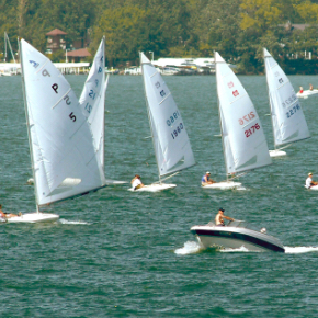 sailboats with white sails on a lake