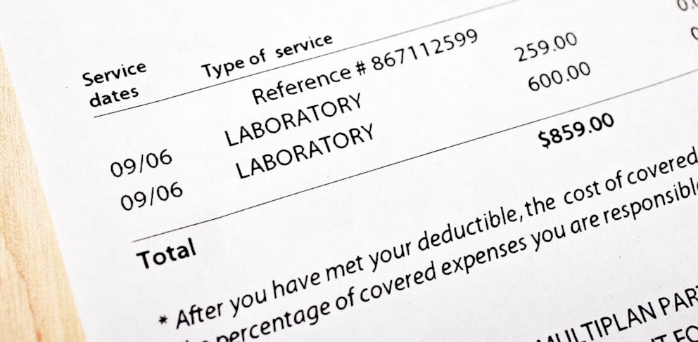 sheet of paper with laboratory expenses listed