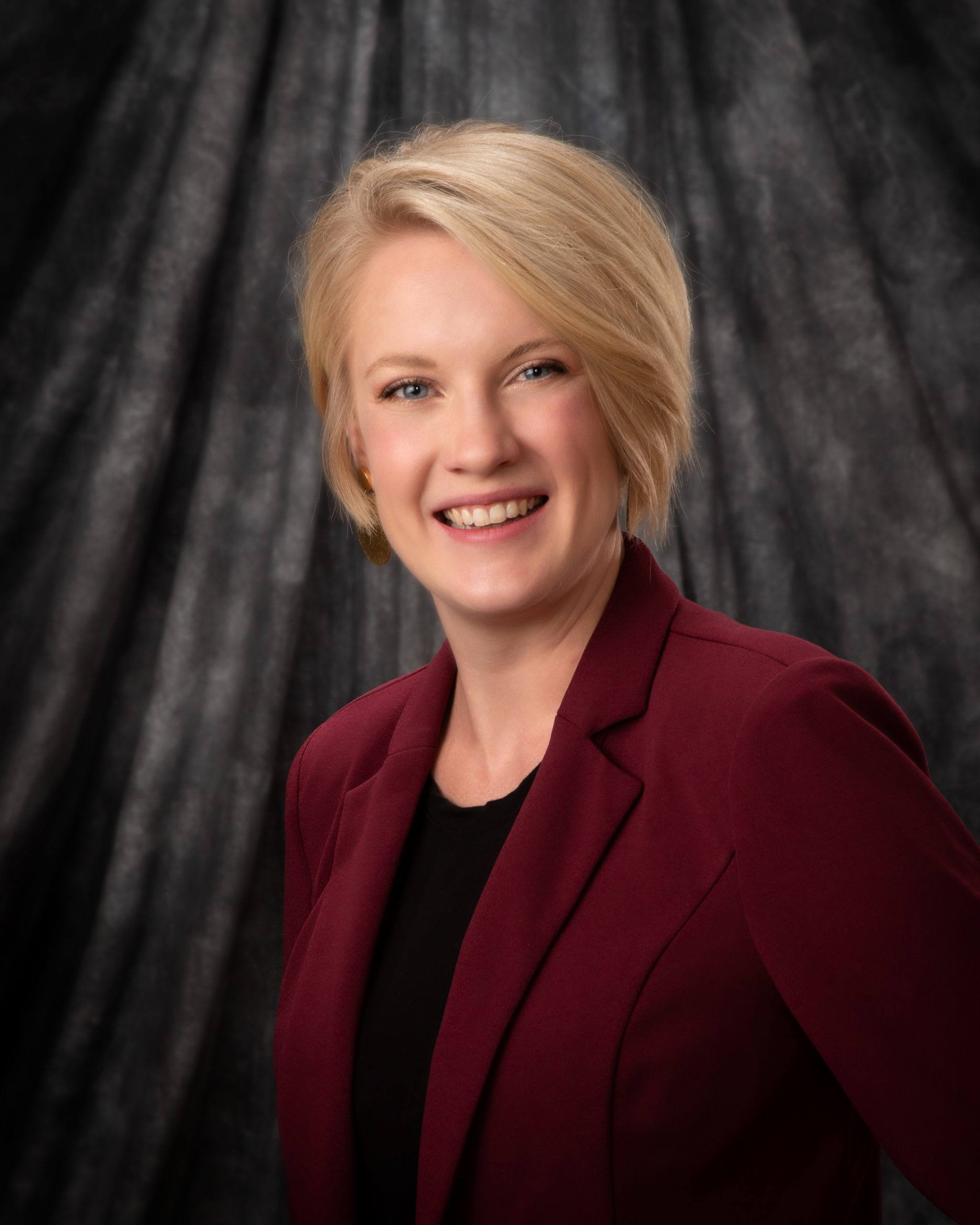 Dr. Whitney Nelson wearing a burgundy blazer and black top