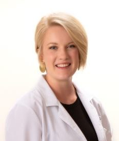 Dr. Nelson wearing a black top and white jacket